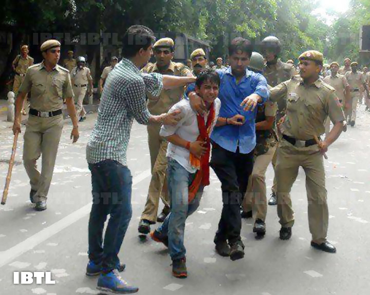 Ankit & ABVP State Secretary Rohit Chahal being taken by police