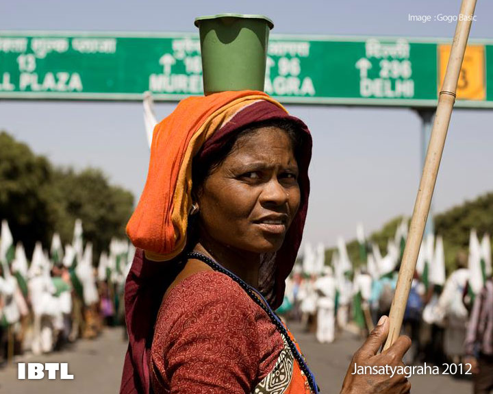 Women carrying a small mug on her head, 296 km to Delhi
