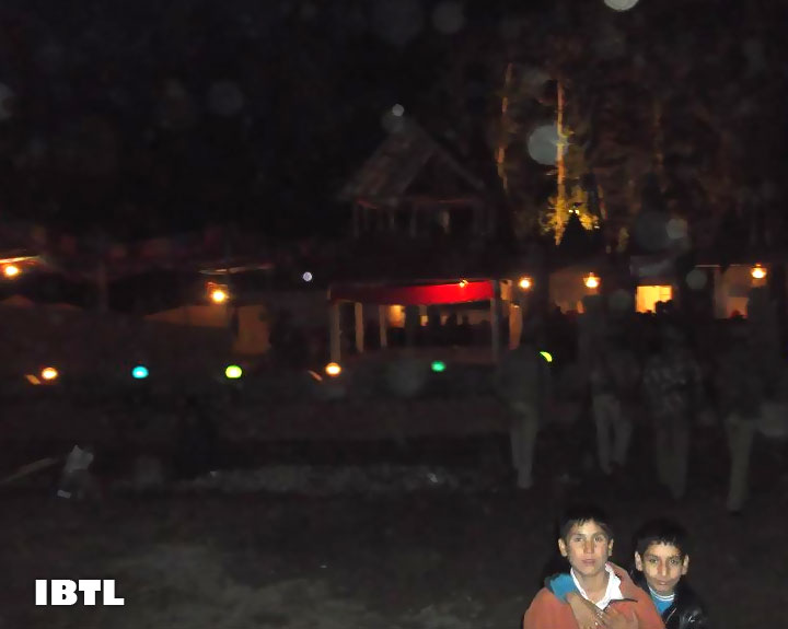 Kashmiri children play outside the Temple at nightfall